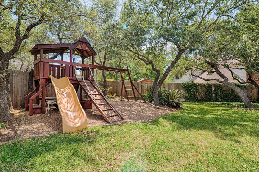 Swings, monkey bars, slides, and a drawbridge-like climbing wall ensure that this playset will get plenty of use over the years.