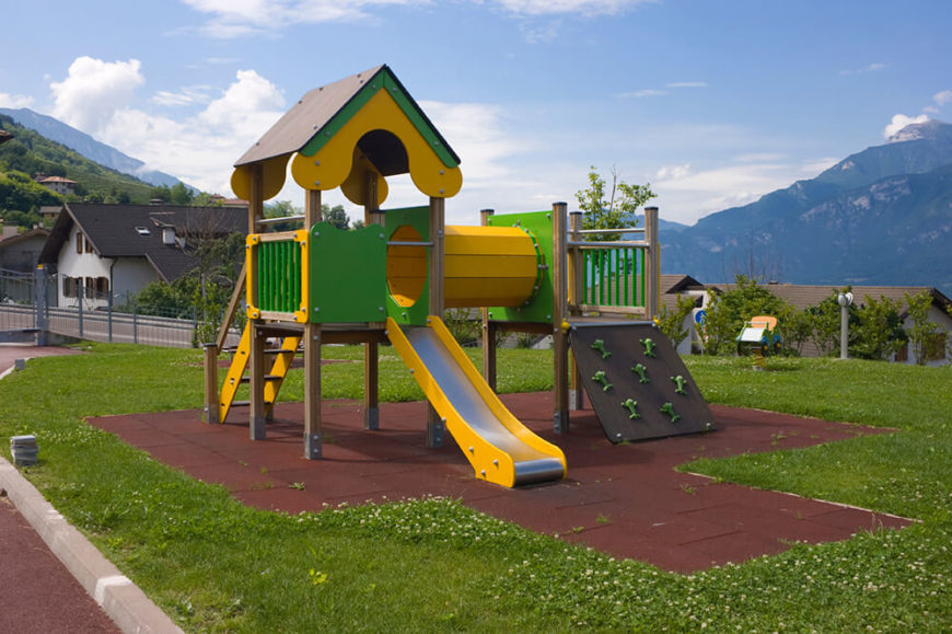 This green and yellow playset includes a slide, climbing wall, and a tunnel to crawl through.