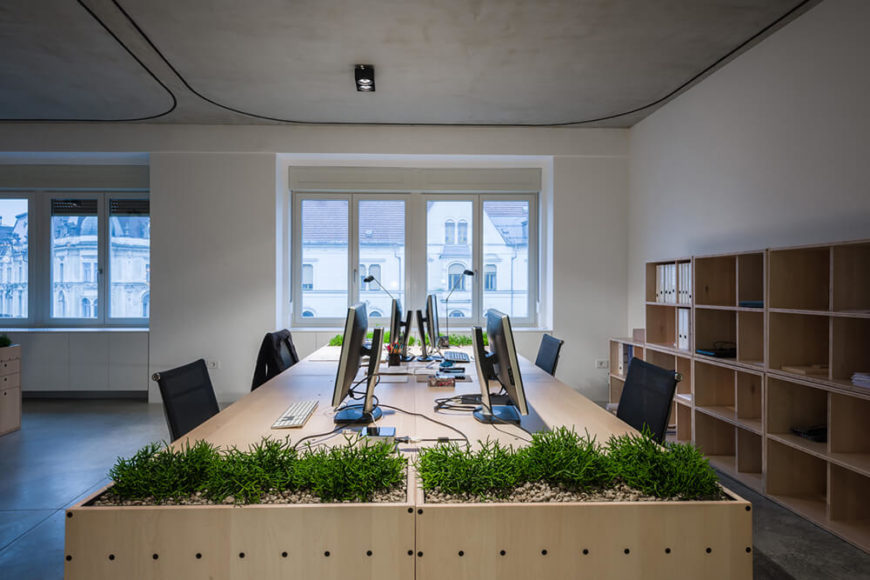 In this image and the following sequence, we see the complete transformation possible with the interconnected curtain system. At first, this corner of the office is part of a much larger collaborative space.