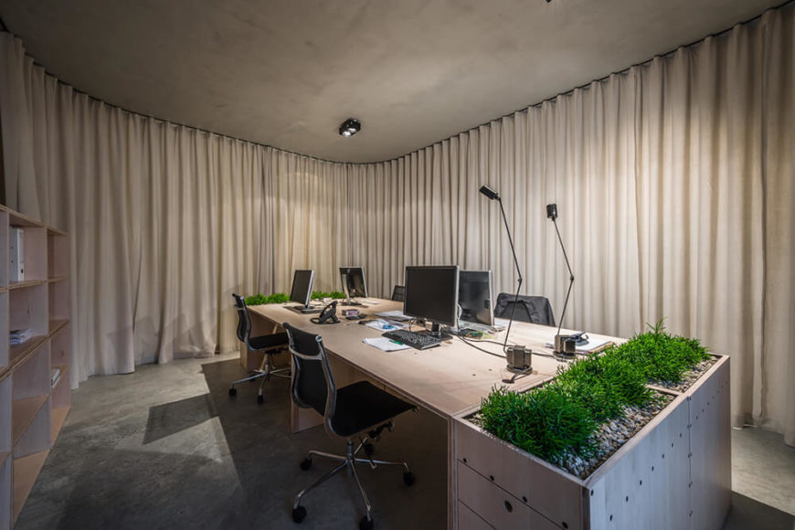 Now we turn around, facing the remainder of the office space. The curtains have created a completely closed off office, making for better quiet concentration or segmented work efforts.