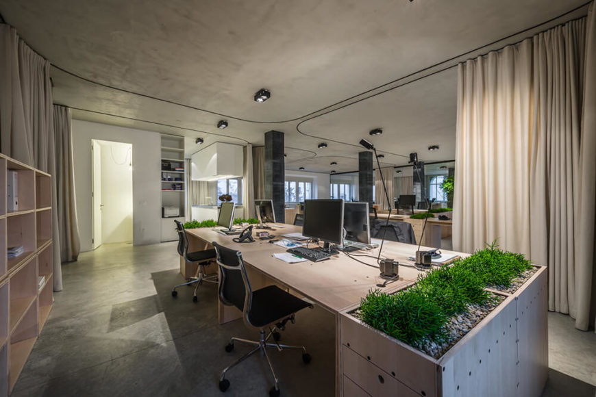 As the curtains draw open further, the area across is revealed to be a bespoke in-office kitchen. Meanwhile we can now see across the vast common area to the other corners of the building.