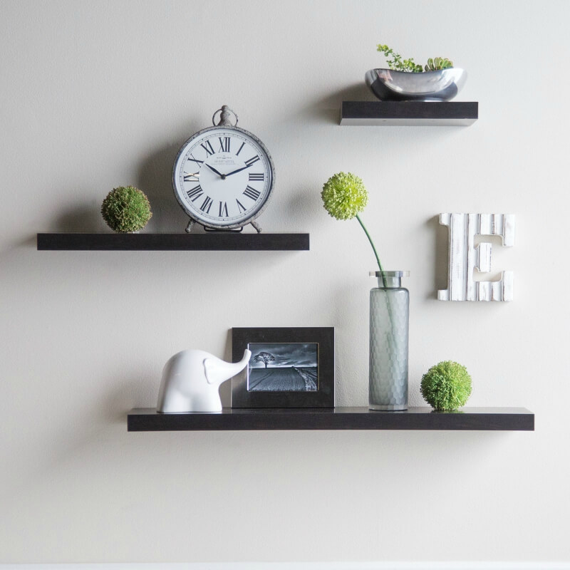 The above floating shelves are minimalist yet offer storage options as well as a decorative function.