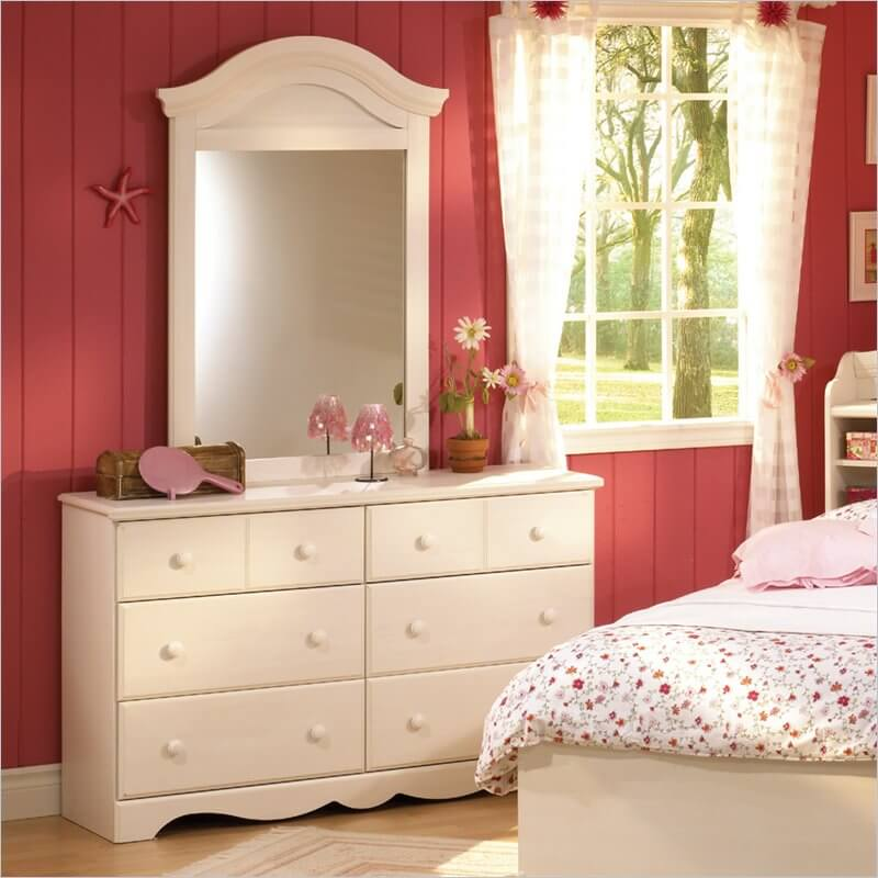 Shown in a little girl's room, a simple chair could transform this into a dresser that pulls double-duty as a makeup table. The small drawers at the top are perfect for holding small implements.