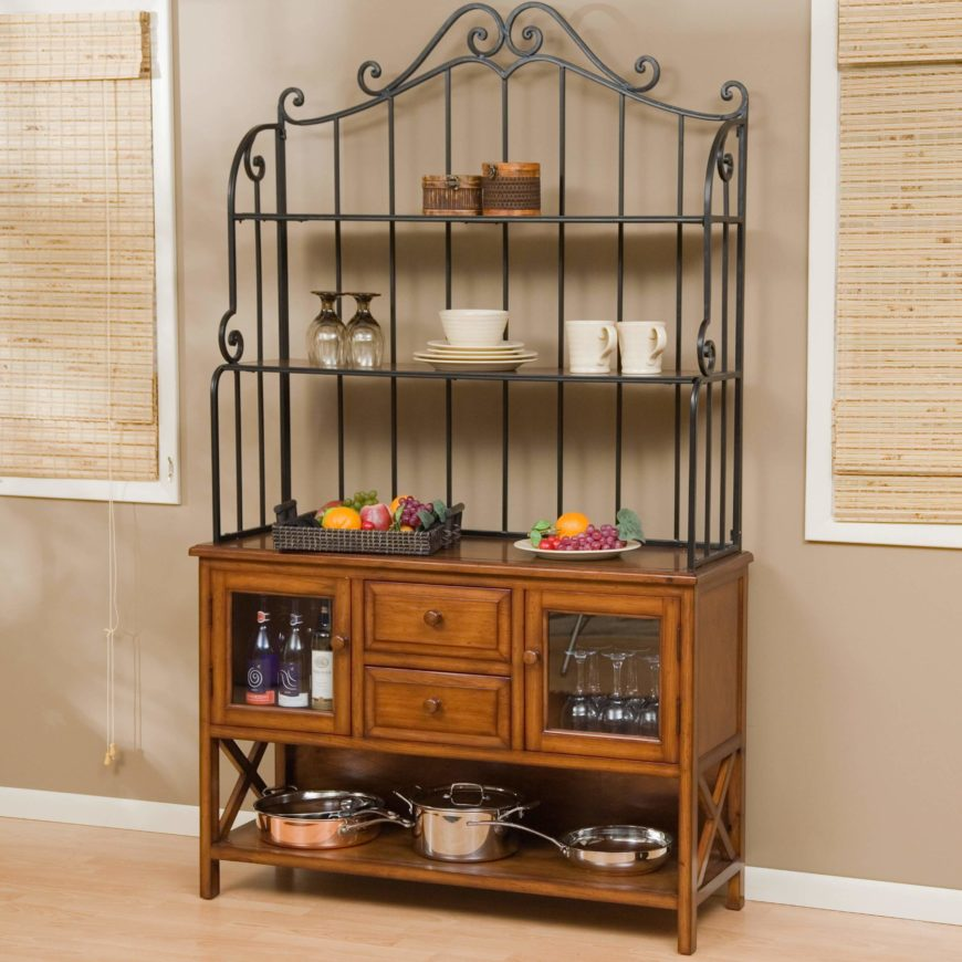 While the wrought iron shelves are used as an attractive display, the bottom is used as a mini bar and as a pot rack.