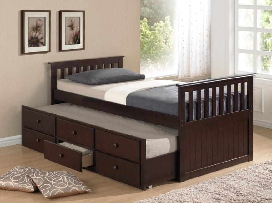 This trundle bed also has three drawers built into the side for additional storage, and is perfect for sleepovers.