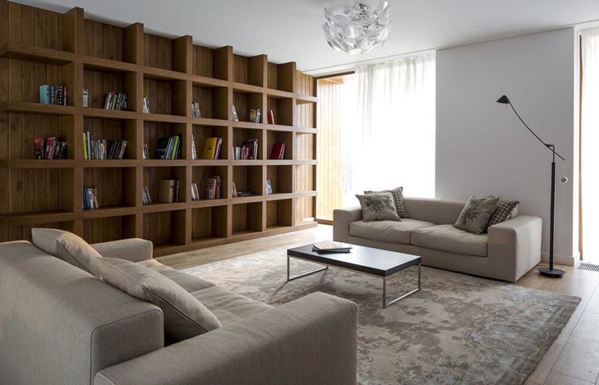 Following the stairs to the second floor, we enter the smaller family room and library. This is a spacious area that could easily be made into a nursery or children's room if necessary. Panoramic windows let in plenty of natural light, and are covered by airy sheer curtains.