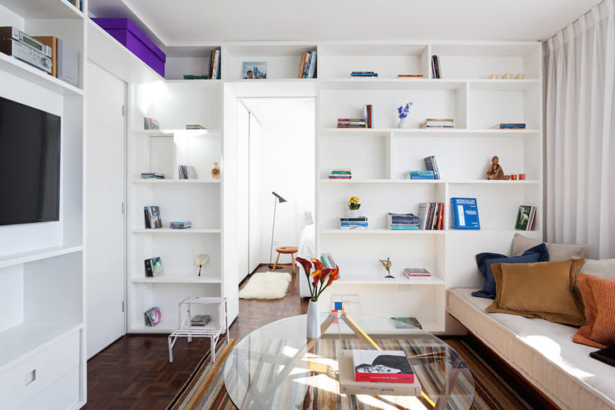 This beautiful home has a flowing set of shelves that move from the floor all the way along the ceiling. Despite the compacted space in the communal area, there is plenty of storage room.