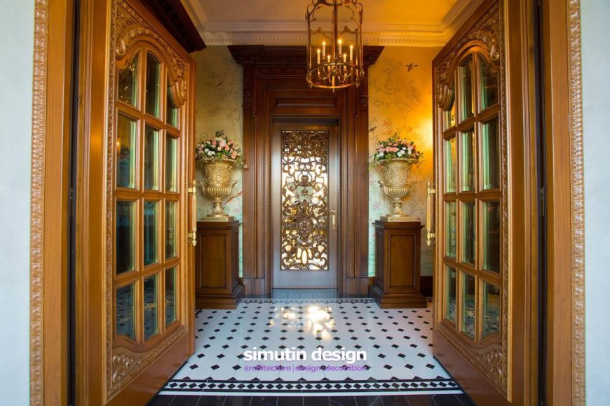 Entry to the home is provided through two incredible rich golden wood doors. The entry is rather narrow, with a single gilded door leading out. The walls are lined with gilded urns filled with fresh flowers. Subtle murals of trees and birds grace the walls.