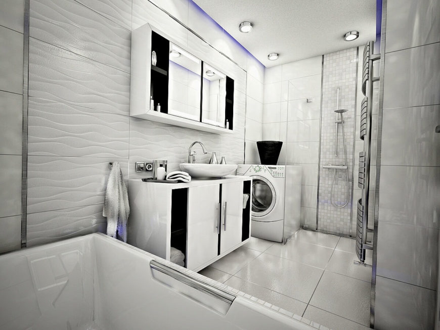 In this last image, we can see the whole of the bathroom, including the laundry facilities. We leave you to admire the unique features of this monochromatic space.