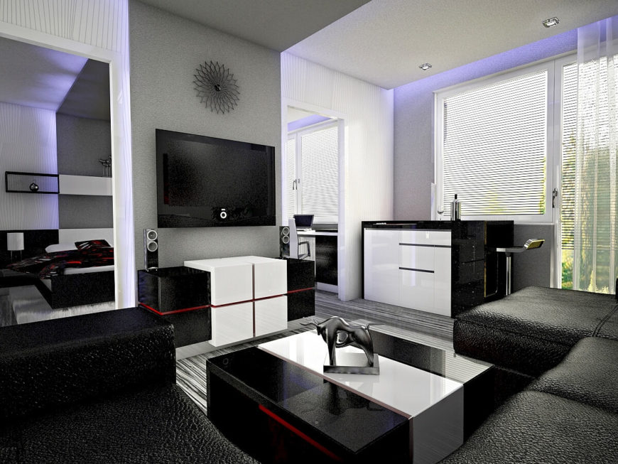 From the adjoining room we can see that it is only separated from the sleeping area by a small centered wall. Like the other side of the wall, a television is positioned in the center above a modern entertainment center. Bull statuettes are a continuing motif on this side of the suite as well. To the right, we see a small bar area.