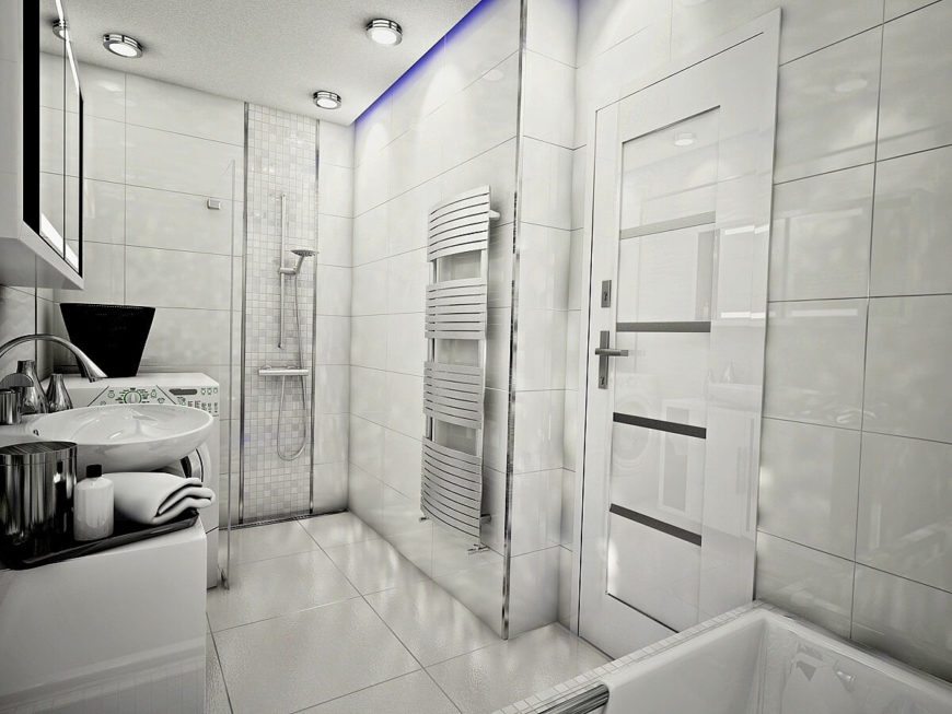 The shower on the opposite side of the room is separated from the washing machine by a plate of glass. This unique primary bathroom mixes luxury with functionality by including laundry facilities in the primary bathroom.
