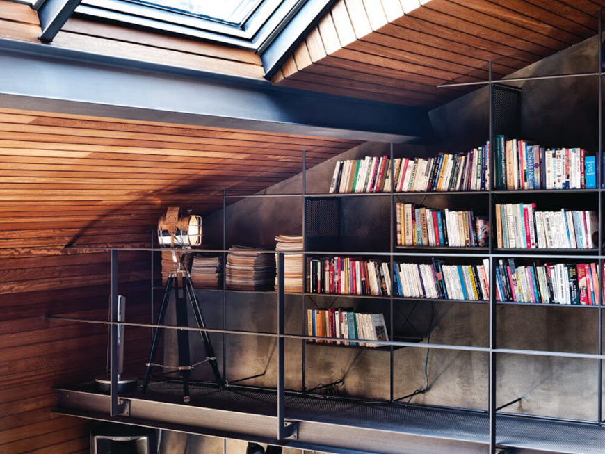 On the far corner of this upper level, we see the wall storage framework become a true library, with book-sized shelving and uniform spacers for an organized layout.