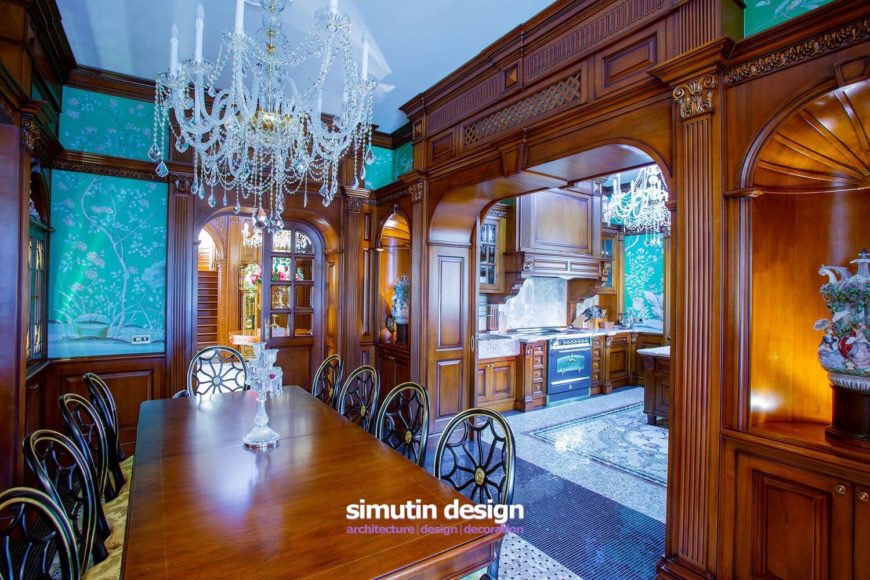 From this angle, we can see into the adjacent kitchen, and into small lighted alcoves that display the owner's beautiful works of art. Note that each archway contains hidden pocket doors that can be used to close off the connected rooms during a dinner party or other social event.
