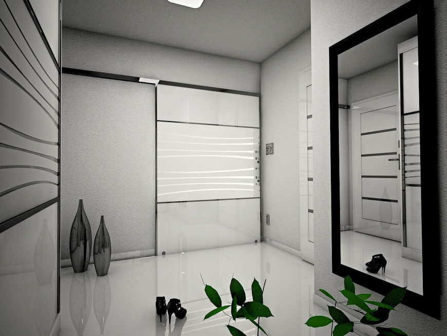 Luxurious foyer with decorative frosted glass panels along the gray walls. It has a full-length mirror and modern vases that add elegance to the entryway.