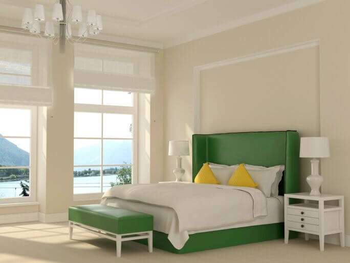 This bedroom makes use of both white and green furniture. Allowing the green bed to play focal point. Accenting it with simple white furniture and yellow throw pillows is a bold, and successful, choice.