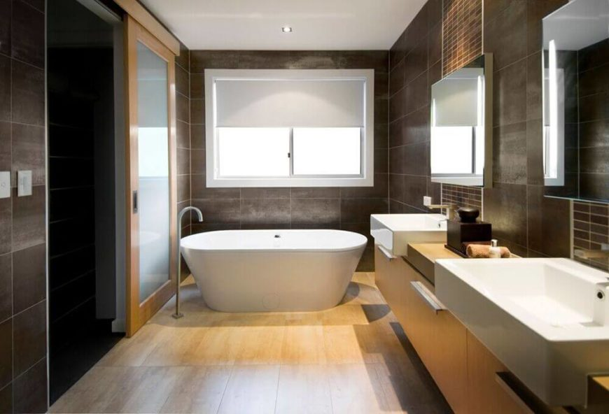 This gorgeous, calming bathroom is a great example of how to incorporate square sinks in a narrow vanity, allowing for more floor space in the bathroom.