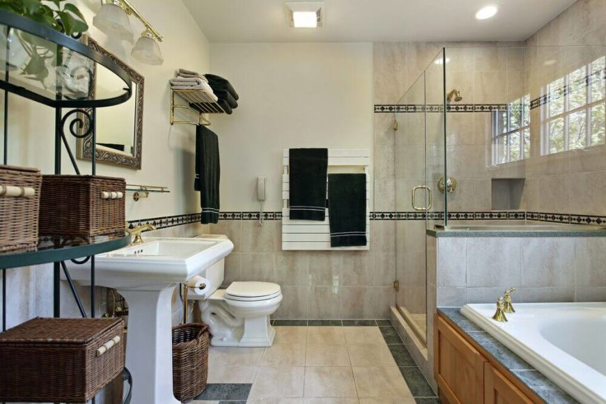 This lovely bathroom uses a deep forest green as an accent throughout the room. The pedestal sink, toilet, and tub offer lovely white accents against the off white tiles lining the shower and bottom half of the walls.