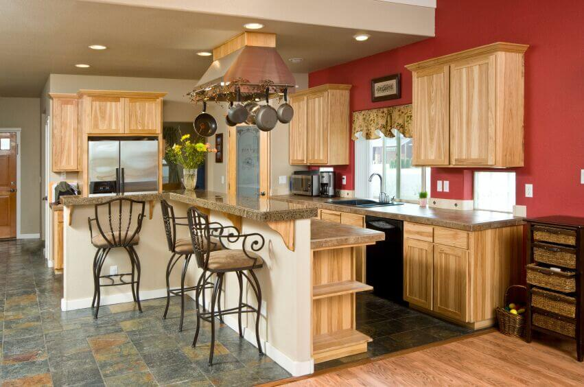 Including this pot rack around the edge of the stove hood is a great way to utilize more functional space without having to clutter up the room.