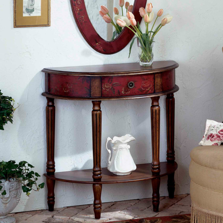 Floral inlays on the front of this lovely red and rich wood foyer table add a delicate side to this elegant piece. A single drawer on the front is perfect for holding small items.