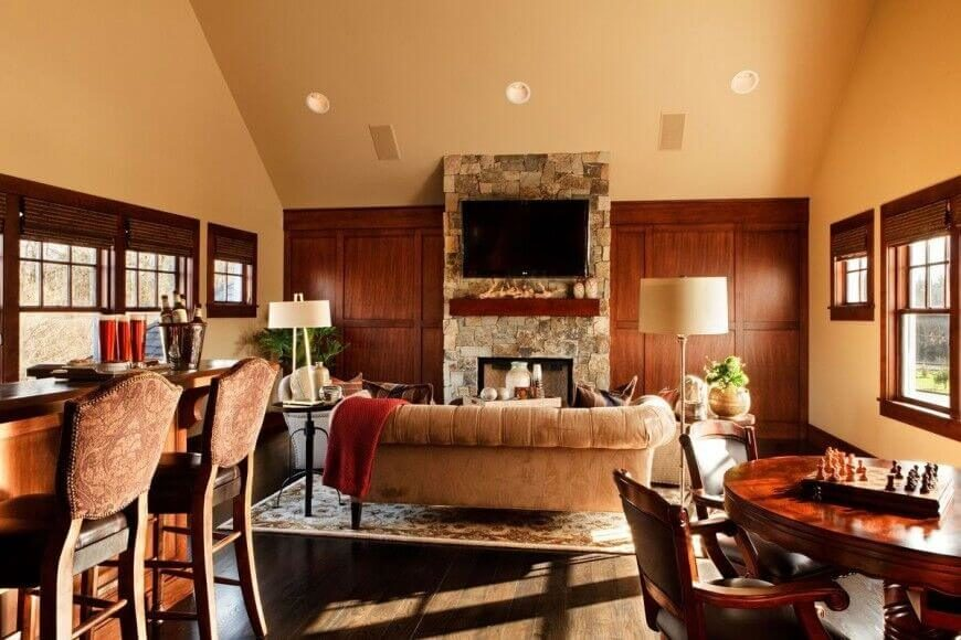 This all-purpose room has a multi-purpose mantle that houses a fireplace and a television. No matter what you want to do in this room, you can be accompanied by the warm fire or the entertainment of the TV.