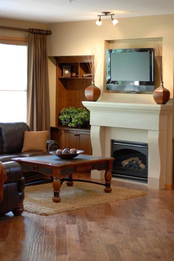 This fireplace is completely seamless, and flows upwards towards the television. The communal area is centered around the fireplace, the floor boards moving towards the middle.