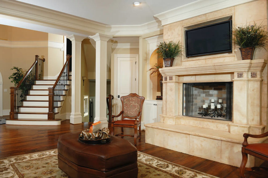 This incredible fireplace is full and luxurious. The television mounted above it does not take any spotlight away from the grand mantle.