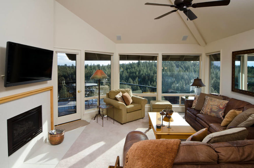 This delightful sunroom has plenty of natural light. In the darkness, a dull fire can invite some soft light into the room while the family enjoys the entertainment of the television before bed.