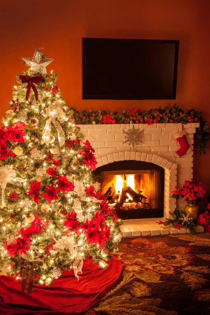 With this gorgeous setup you can have the christmas fireplace and the TV too! Hang the stockings by the old brick fire without having to give up your love for technology.