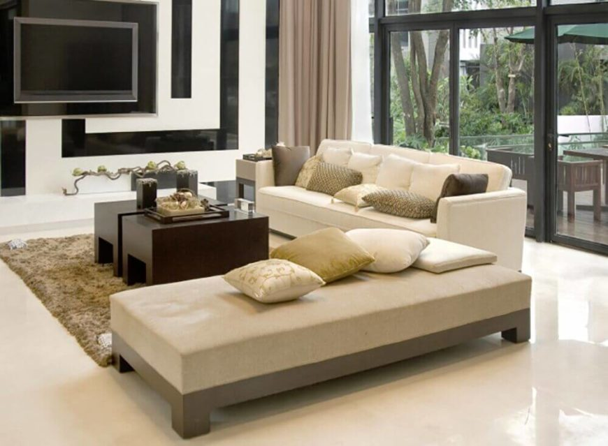 A wide array of pillows add a great deal of visual interest to this simple, neutral sofa and chaise.
