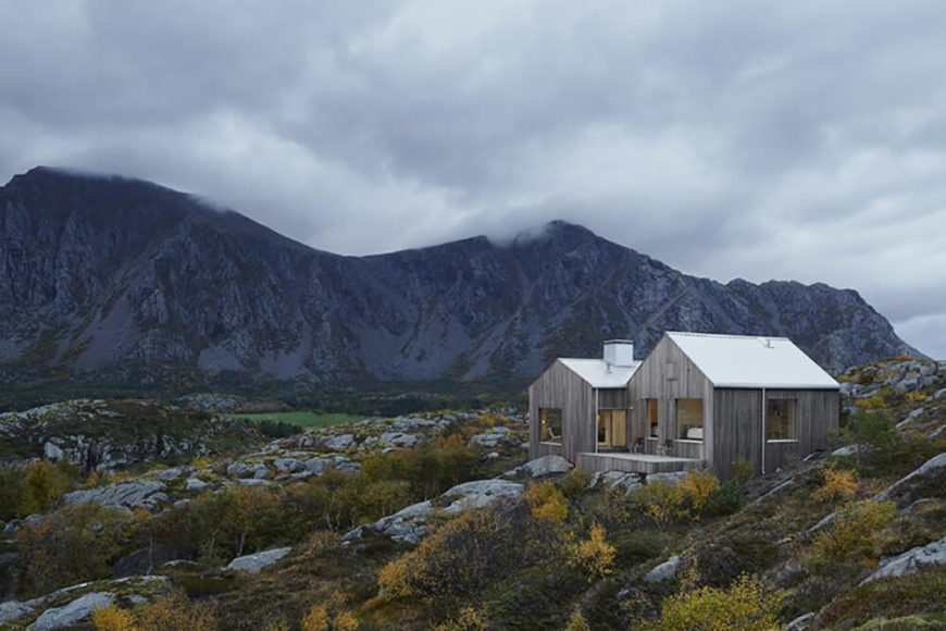Minimalist cottage stands amidst the craggy landscape of Norway.