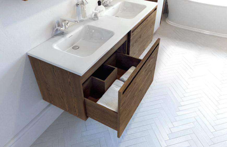 Here we see just the bottom drawer open. The sink and countertops are available in two finishes, glossy or matte and feature his-and-hers sinks. The sinks also feature integrated overflow.