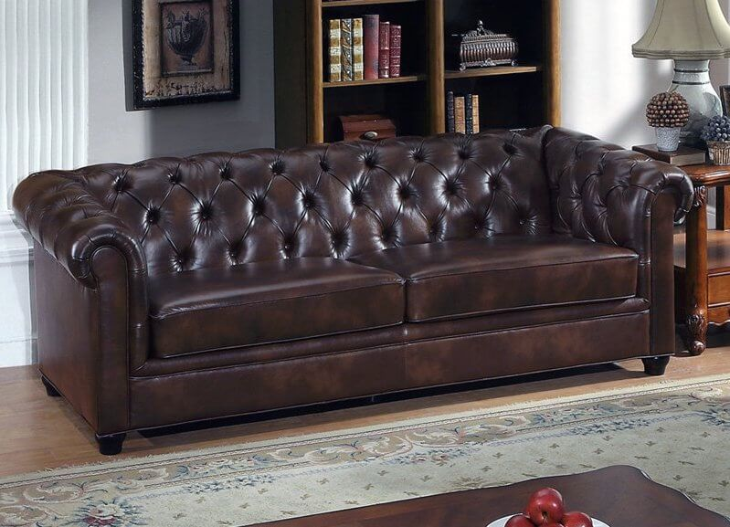 Here is a perfect example of a classically styled brown leather sofa with rolled arms. The traditional looks are bolstered by button tufted Italian leather and a natural wood frame.