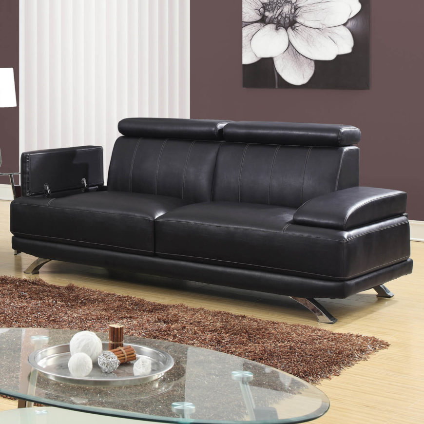 This modern design sofa boasts a unique storage element, with flip-up armrests that conceal a wealth of storage space below. The clean lines and elegant shape of the sofa would look at home in any contemporary man cave setting.