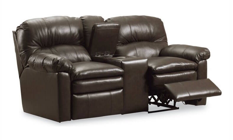 This dark chocolate toned leather wraps a traditional frame, hiding a central built-in storage console and cupholders. The pair of reclining seats feature thick cushioning and seamless integration.