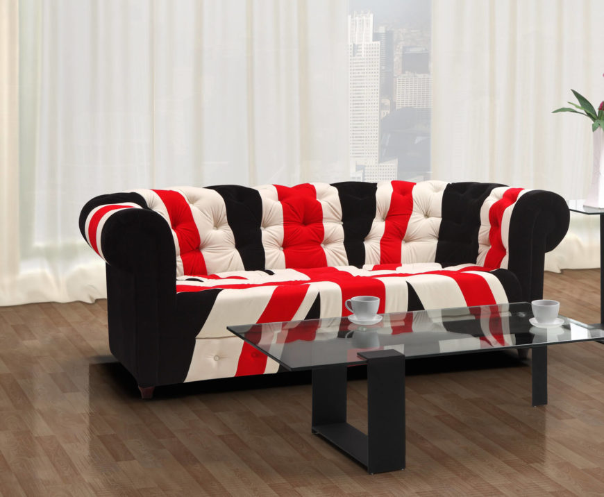 This is our favorite themed sofa in the list, a bright and bold Union Jack design roll arm with thickly padded button tufted backing. The body is framed in deep blue while the brighter colors of the flag make it stand out in any space.
