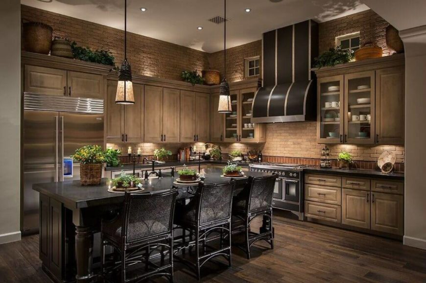 The combination of color and textures in this stunning kitchen make this an eye-catching addition to our gallery. The distressed wood cabinets and floor of this kitchen create a great backdrop for the dark wood of the island and the striking silver and black stove.