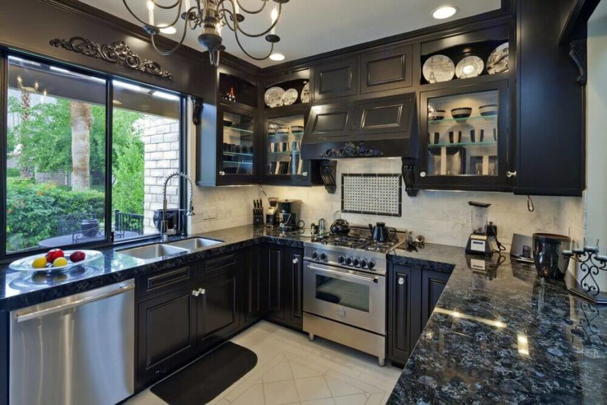 Open shelving balances the use of black cabinetry in this stunning kitchen. Marbled black granite brings together the black cabinets and white backdrop of the rest of the kitchen. Large windows ensure that plenty of light brightens up the room.