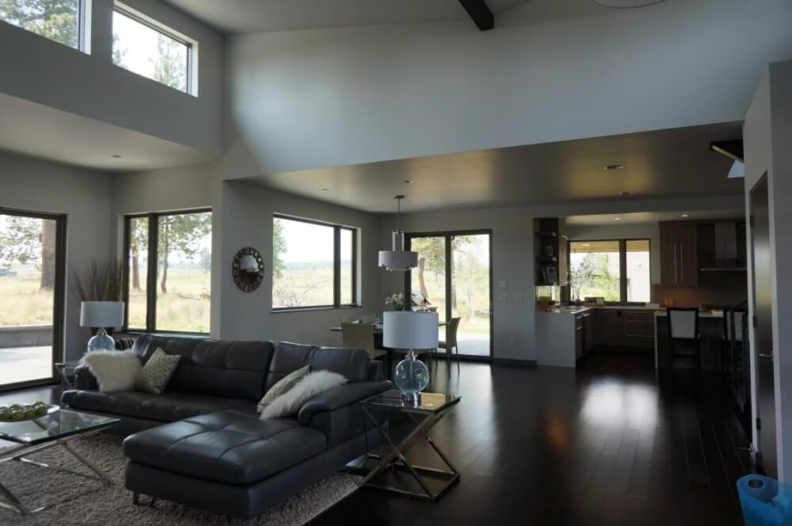 The living and dining areas each hold sliding glass doors for direct patio access, as well as large windows in between. The extra high ceiling here allows for an airy atmosphere and extra daylight.