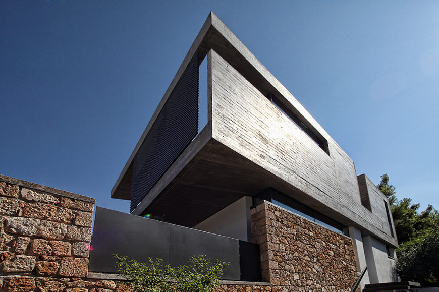 The second story is entirely constructed of thin slabs of exposed concrete, giving it a rough texture that creates a very unique and interesting visual design.