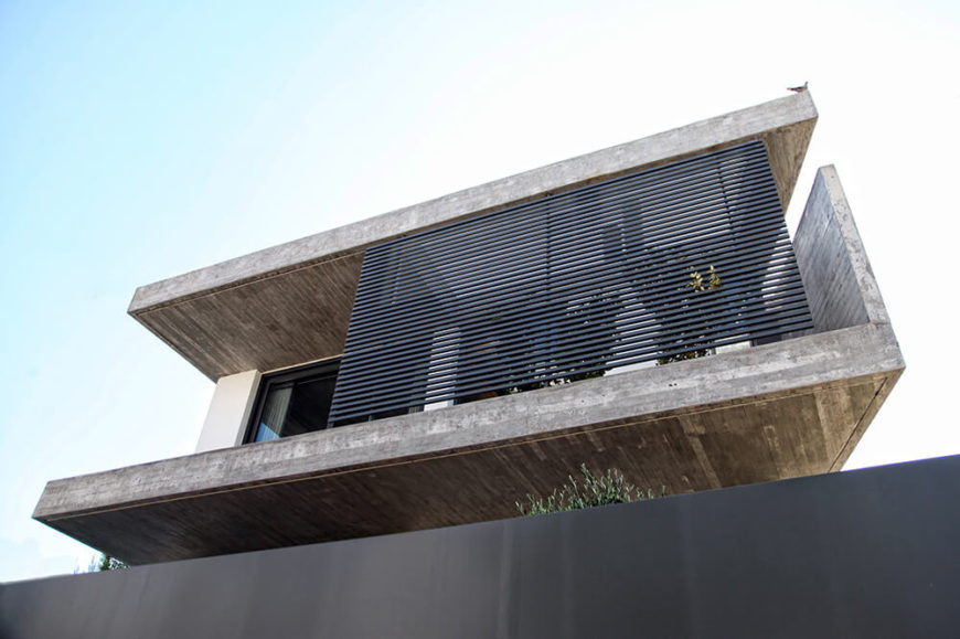 The balcony on the second level has a small garden area that is obscured by the black screen in this picture. The second floor houses the three bedrooms located in the house.