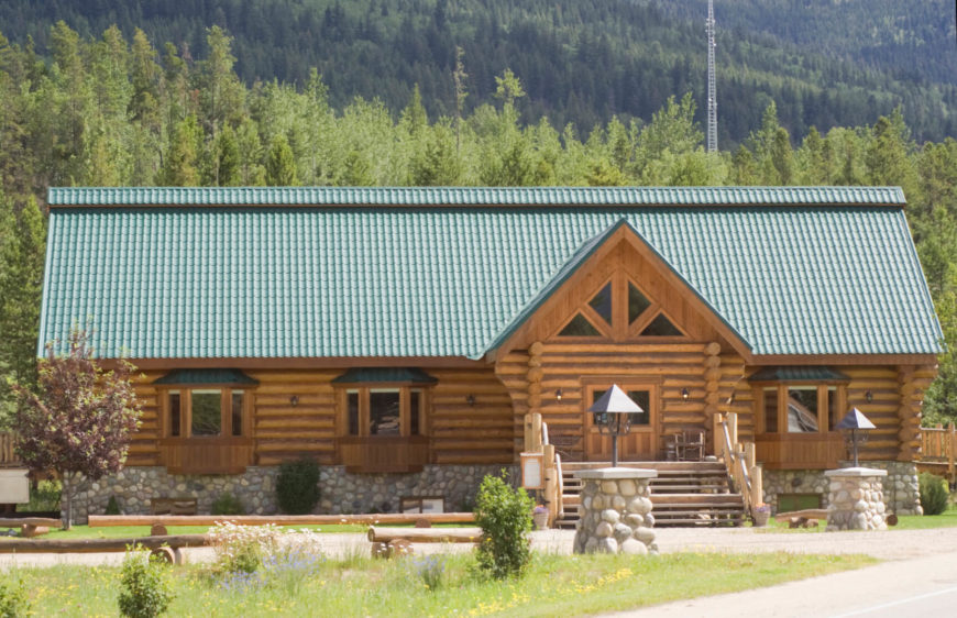 This split log style maintains the cabin feel of this mountain lodge. Split log siding is a striking by high maintenance exterior choice.