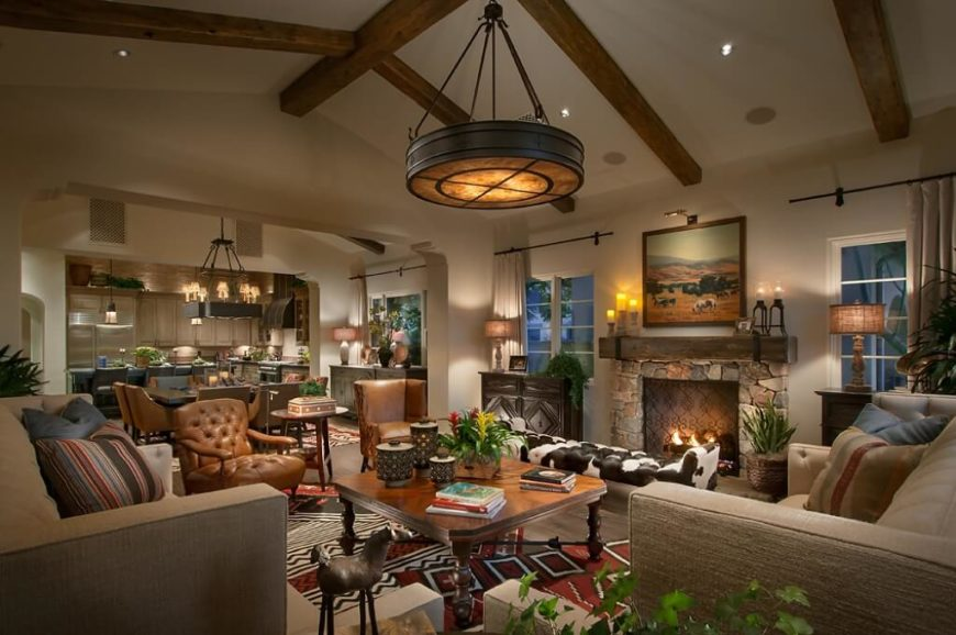 This rustic southwestern themed design uses plants to enhance the down-to-earth feel of the room as a whole. Bold patterns, as in the rug and the cow-skin bench, successfully highlight the space.