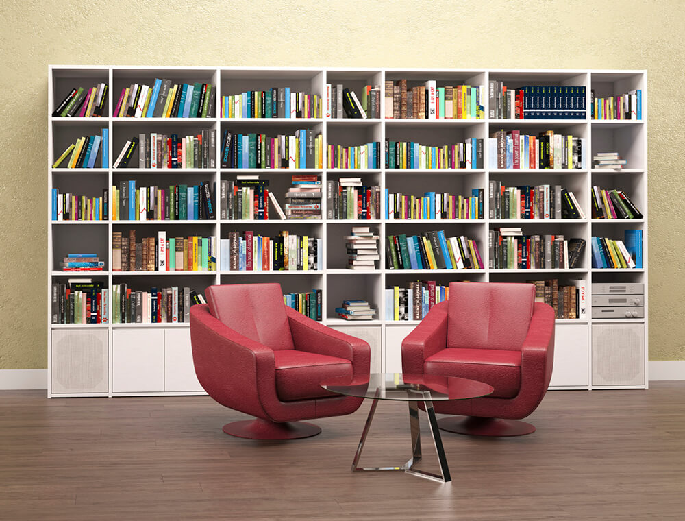 The red seats set on the hardwood flooring of this home library look so perfect together with the white bookshelves set on the back.