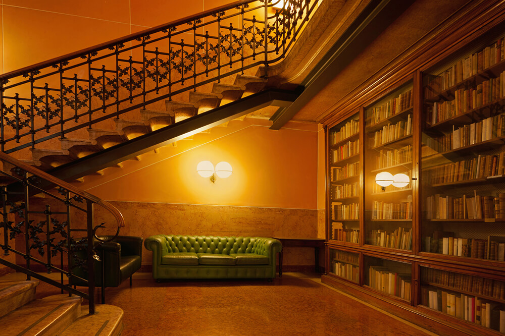 A stunning home library with romantic warm white lights. The bookshelves are just enchanting.