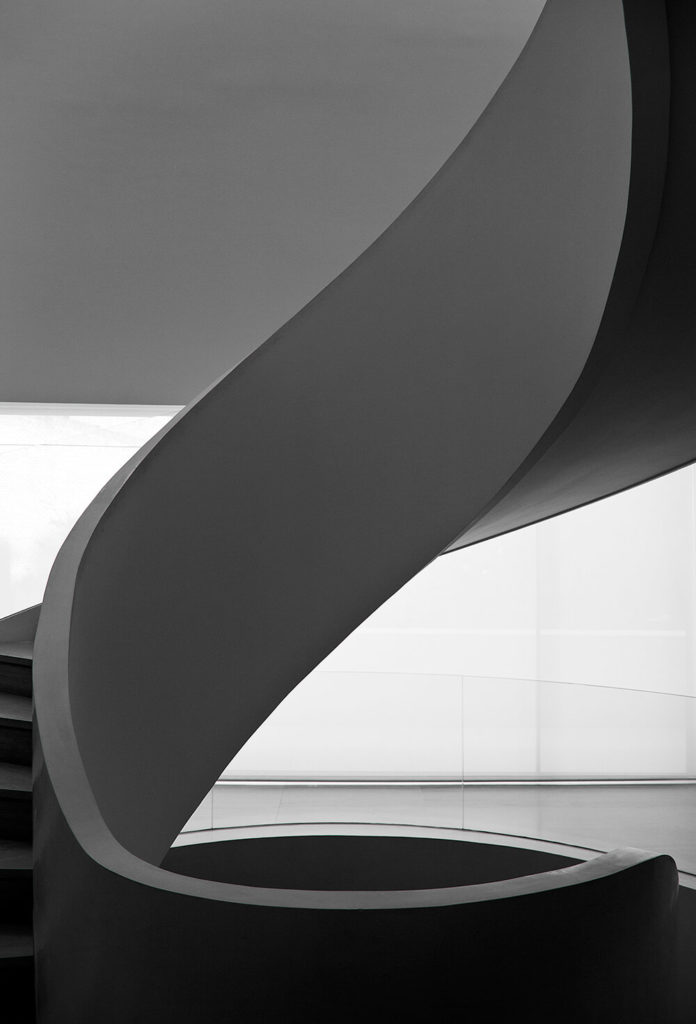 This incredible spiral staircase is a centerpiece of the interior design, fluid and organically sculpted in perfect contrast with the sharp lines and simple angles of the rest of the home.