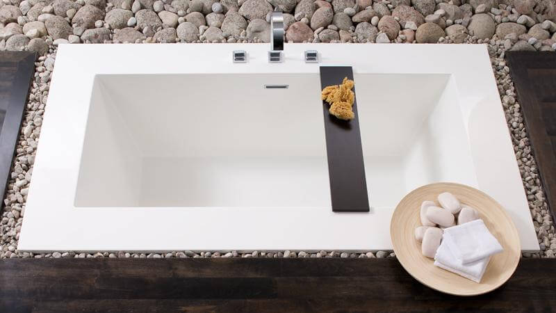 While still featuring the modern cube design and the incredible, luxurious space of the Cube Collection, the BC05 is uniquely designed to be a sunken bathtub. As shown below, the tub can be surrounded with gravel and stones to create a natural feeling relaxation area. The BC05 tub also includes a wenge-colored bathtub caddy.