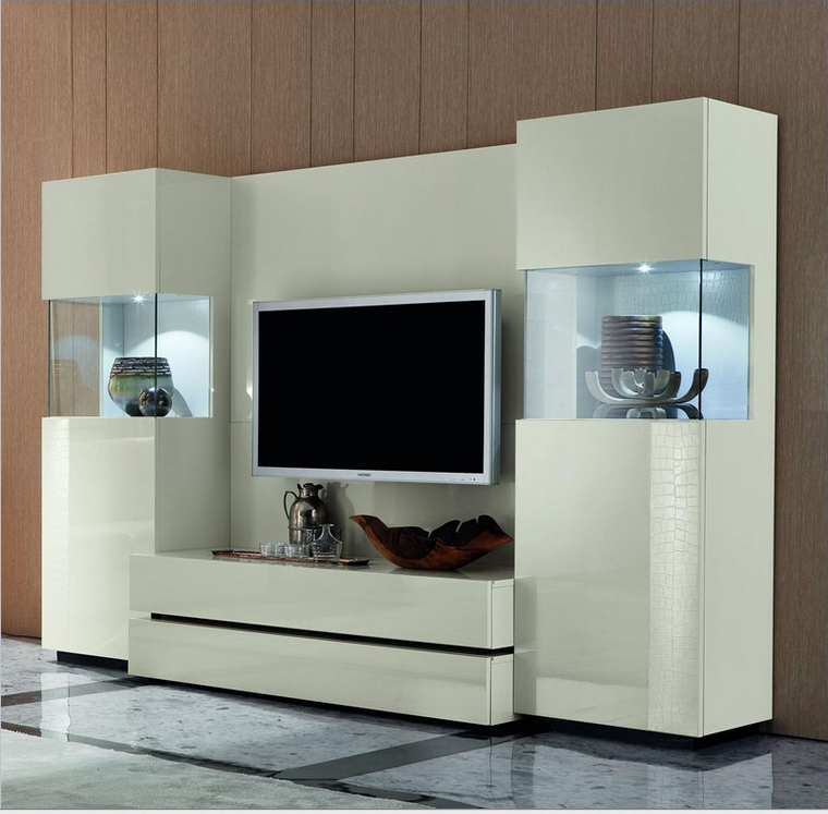 This unit is positively breathtaking in its sleek white construction and pair of glistening glass display cases flanking the main body. Perfect for any high luxury or distinctly modern spaces, its clean lines and unfussy textures mean that the bold singular colors dominate the view. The piece features a pair of sizable drawers on the center unit, making for the ultimate in discreet storage.