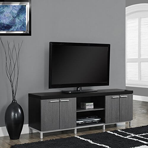 This bespoke unit is buttoned up like a nice tuxedo in black, with a splash of grey and silver hardware. Its space saving simple design offers ample storage and some open shelving, plus a sleek black tabletop that would be perfect as a display shelf if your TV is mounted on the wall above. The styling could go with many styles of man cave, from industrial to modern.
