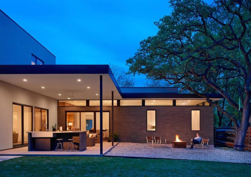 Finally, we see a shot of the backyard and patio space, with a large rock garden and fire pit for relaxing at right. The sheltered patio with a full wet bar is accessible from both the living and family rooms.