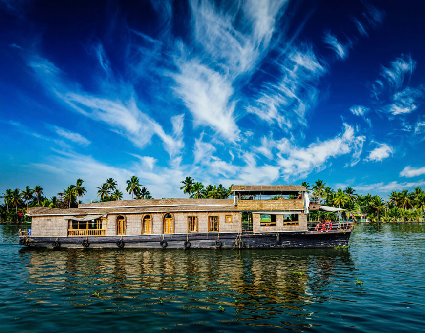 A longer houseboat in Kerala. Note the arched window and door frames, along with an upper tier for a better vantage point.